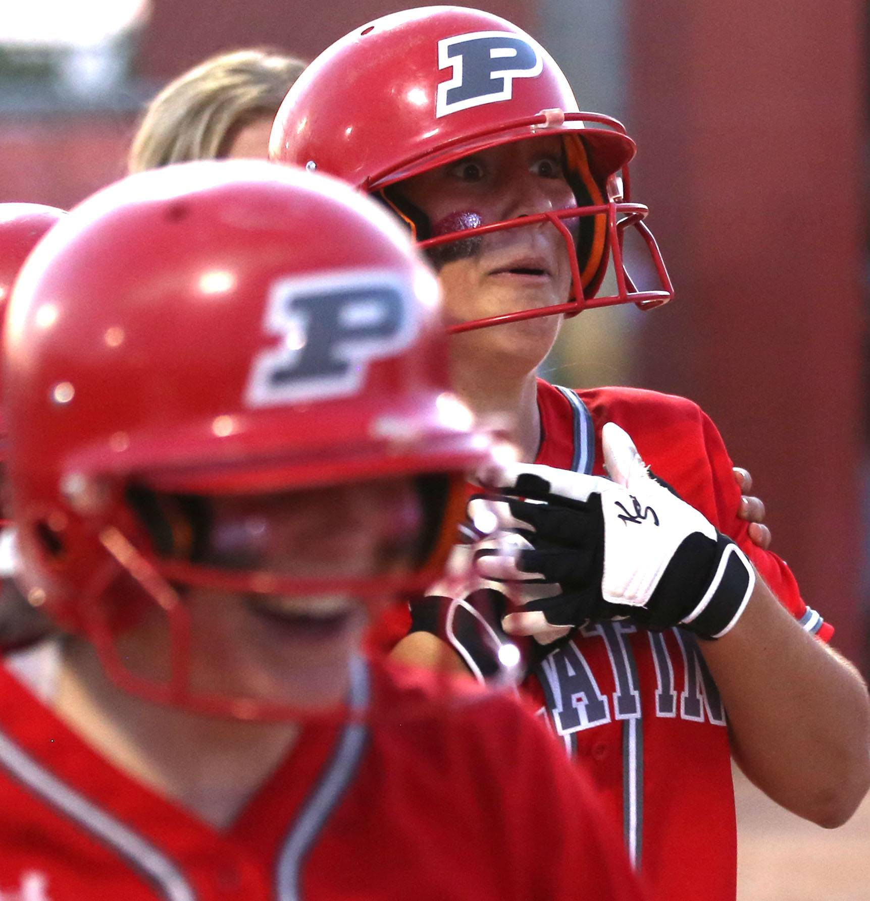 Palatine's Kaitlyn Reed reacts after her home run during Class 4A supersectional action at Barrington on Monday night.
