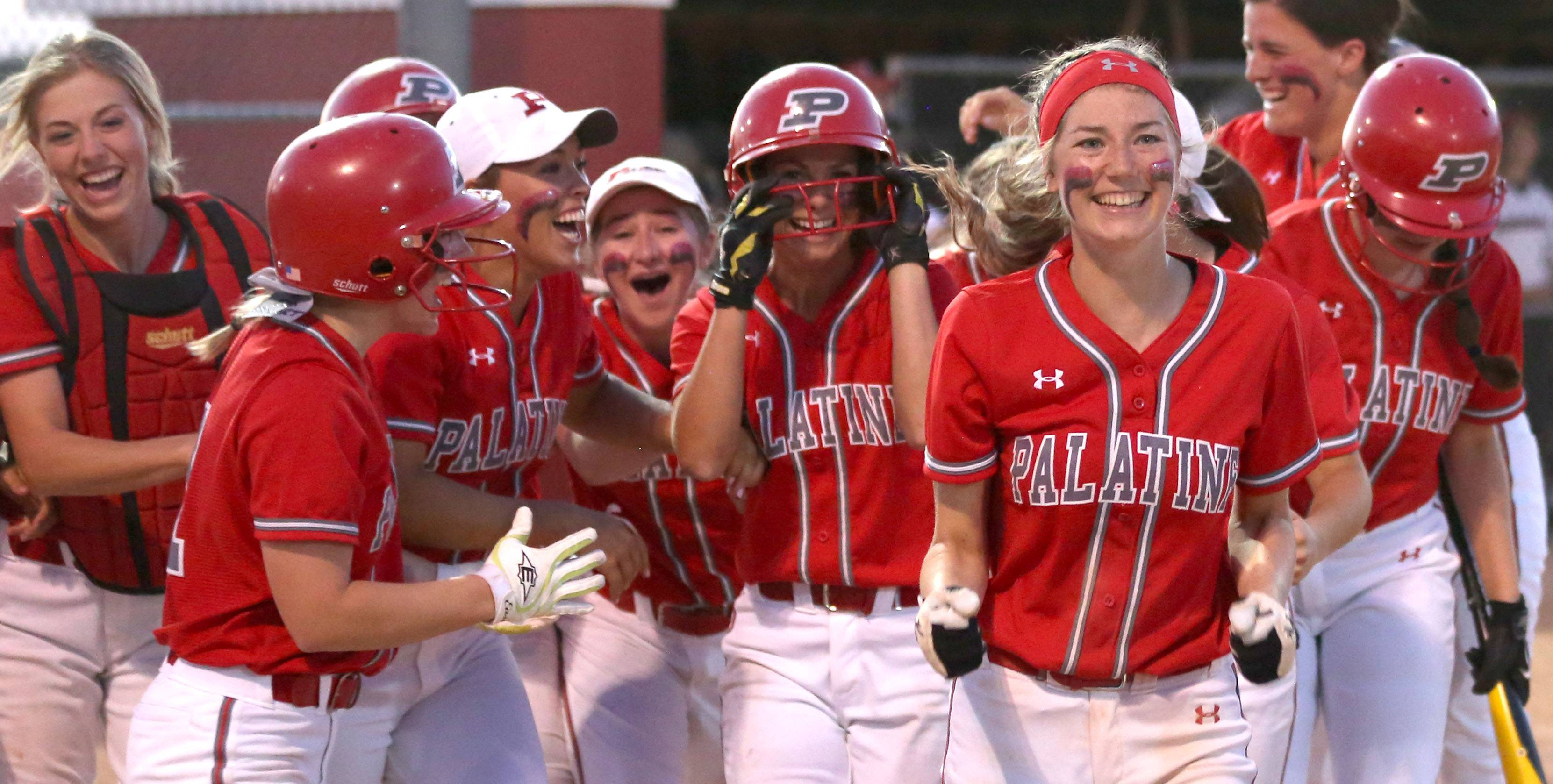 The Pirates are all smiles as Kaitlyn Reed returns to the plate her home run during Class 4A supersectional action at Barrington on Monday night.