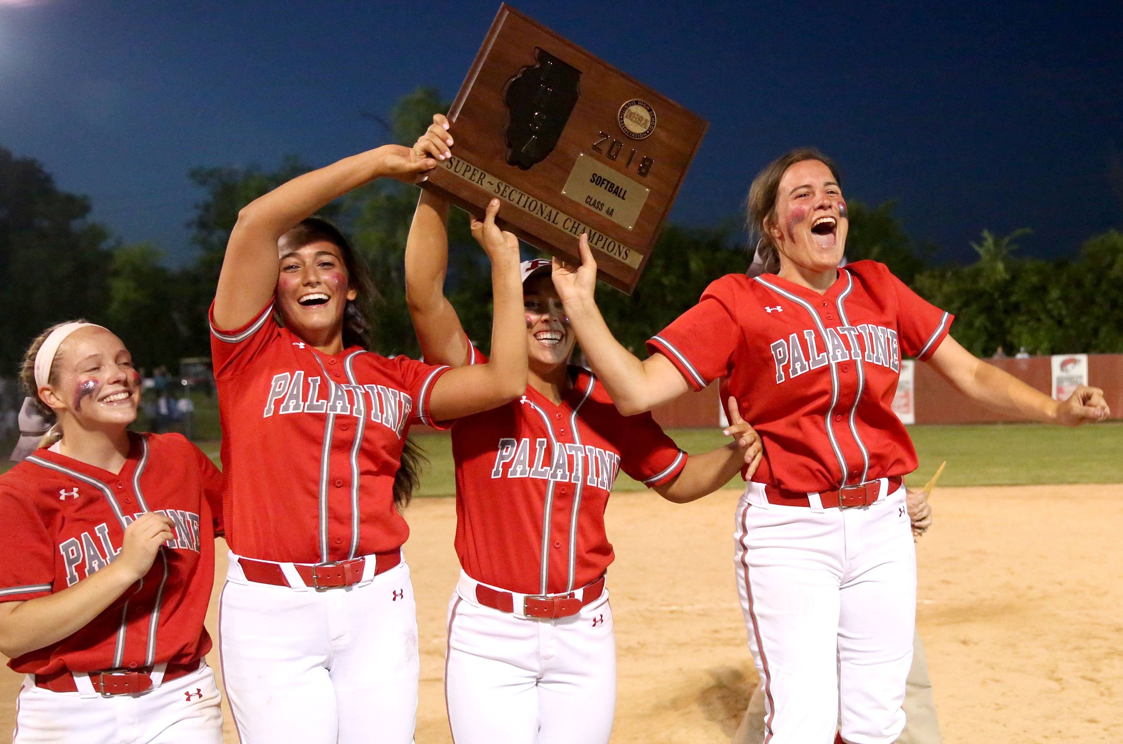The Pirates of Palatine hoist their hardware after a 6-3 win in the Class 4A supersectional at Barrington on Monday night.