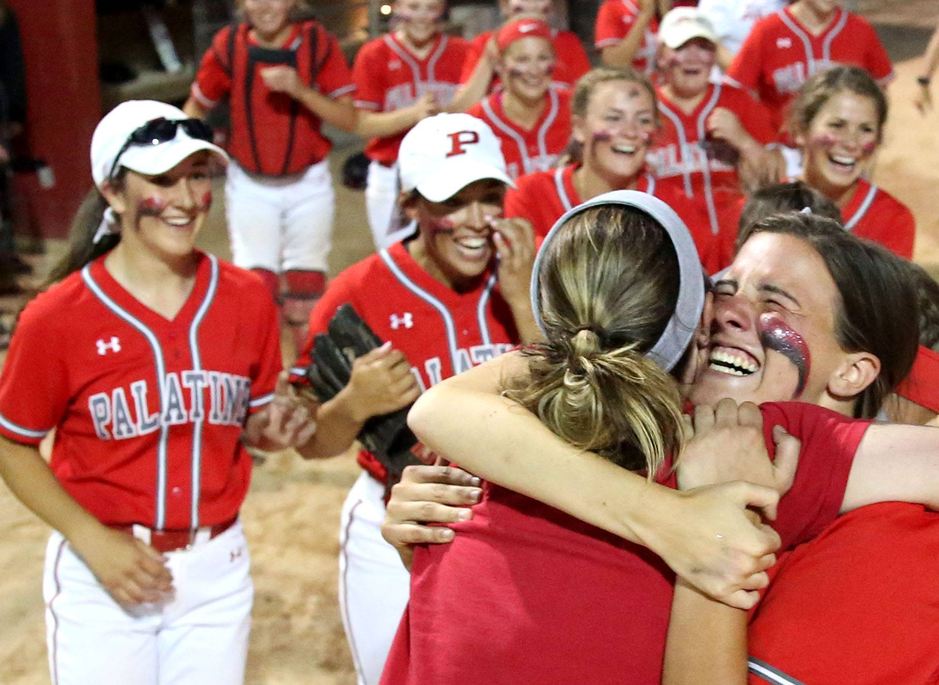 Palatine celebrates its 6-3 win in the Class 4A supersectional at Barrington on Monday night.