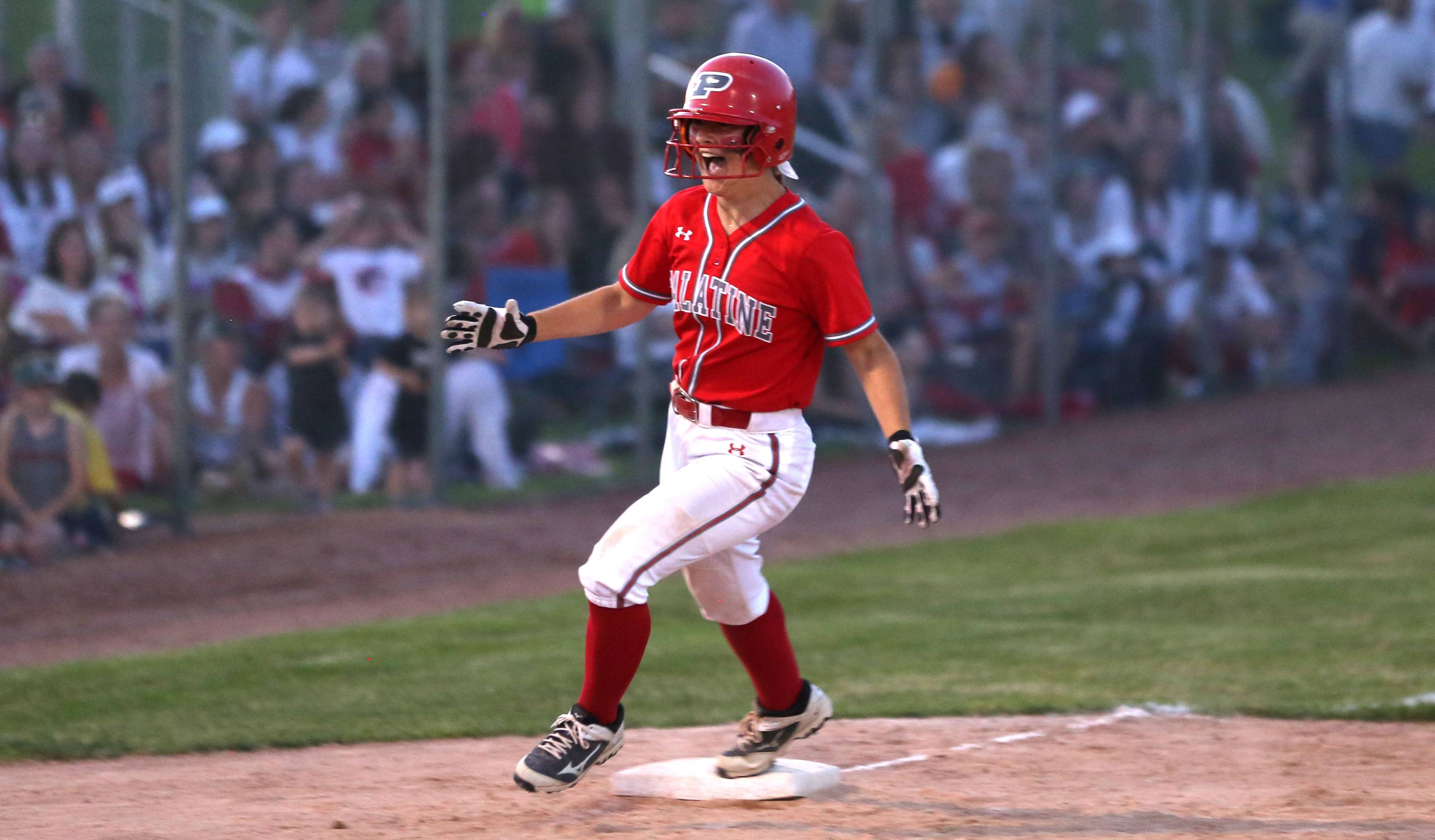 Palatine's Kaitlyn Reed is all smiles rounding third base after slugging a 3-run homer in Class 4A supersectional action at Barrington on Monday night.