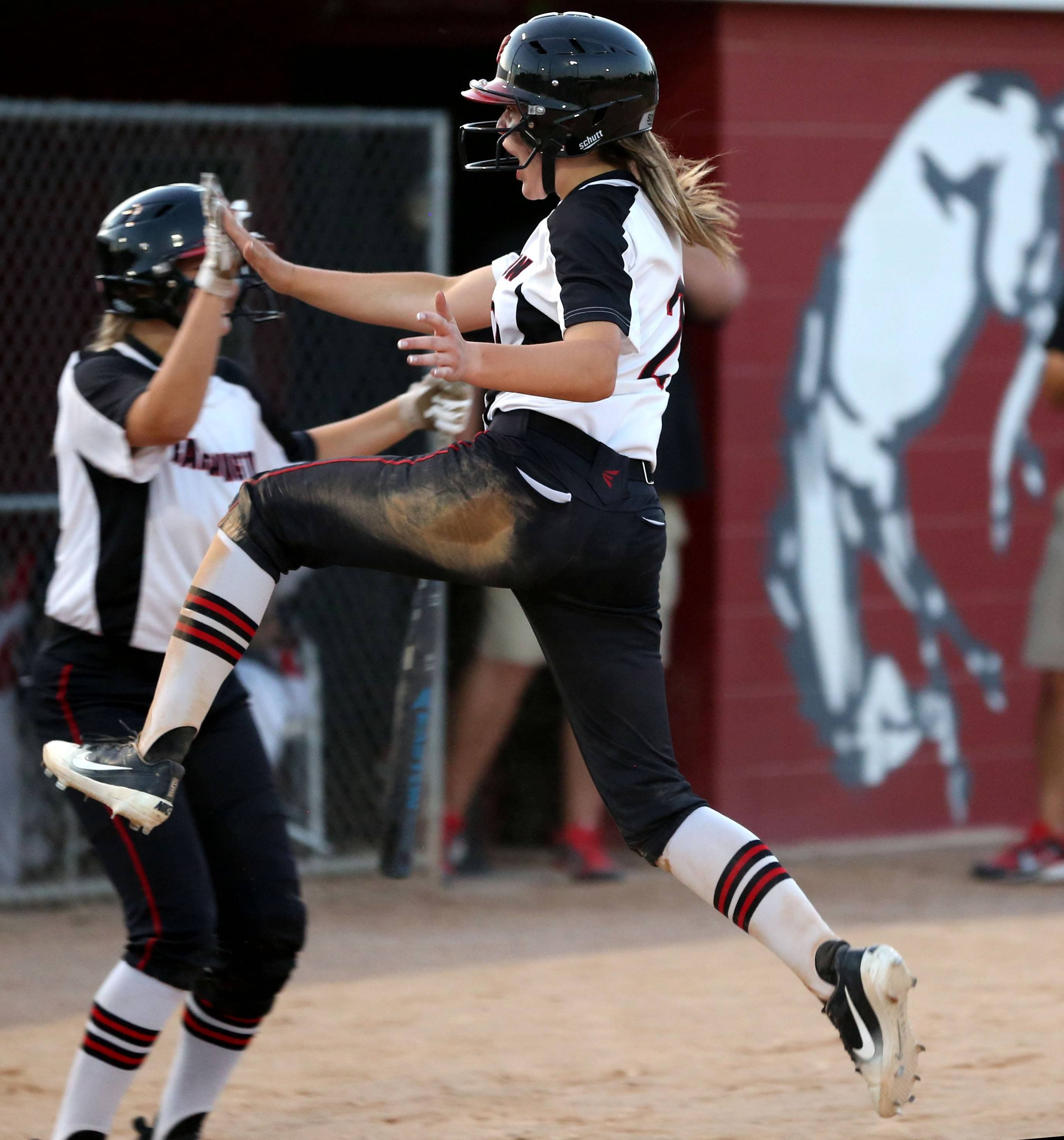 Barrington's Abbey Jacobsen leaps for joy after belting an RBI double in Class 4A supersectional action against Palatine at Barrington on Monday night.