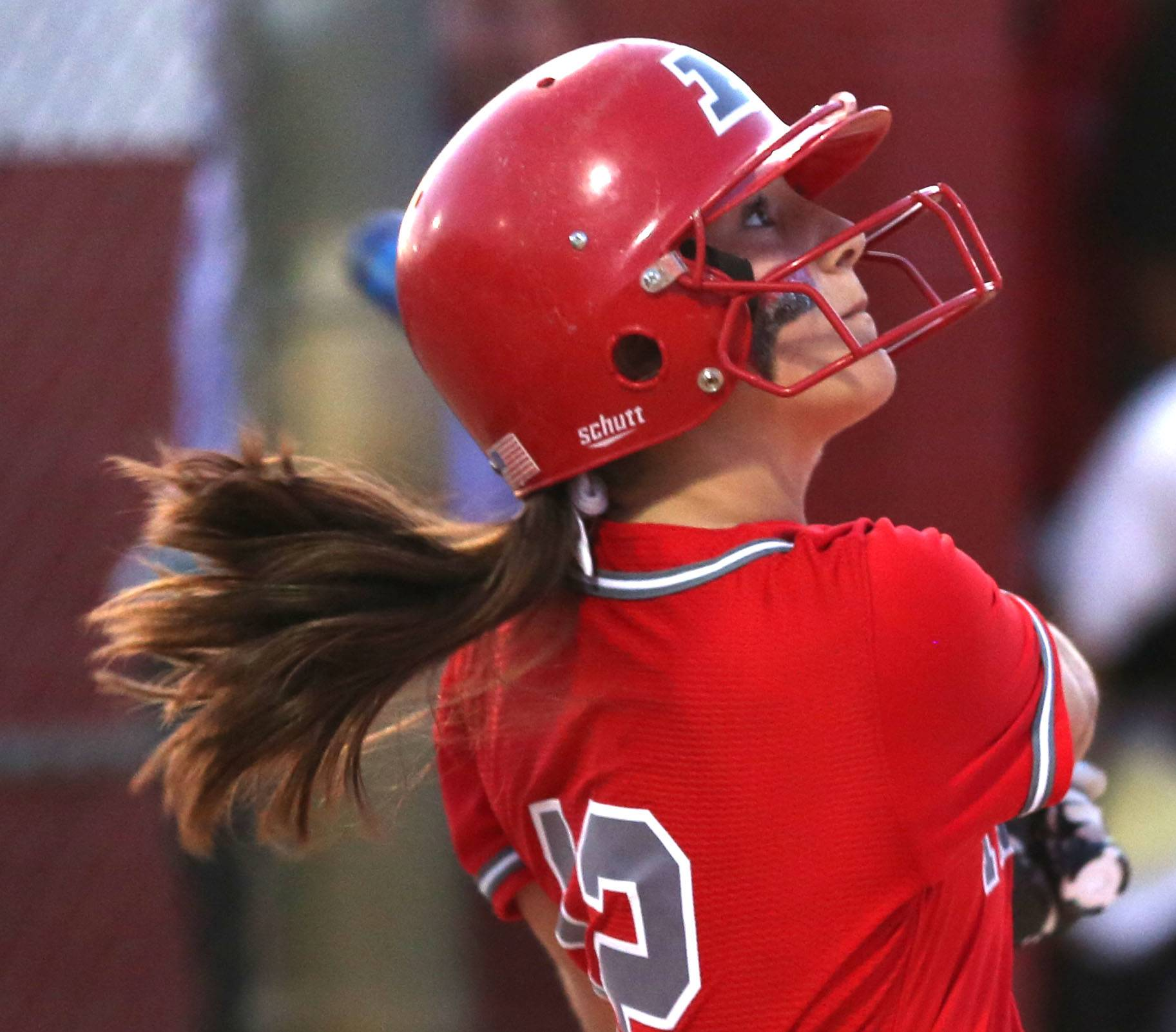 Palatine's Kaitlyn Reed watches the flight of her 3-run homer during Class 4A supersectional softball action at Barrington on Monday night.