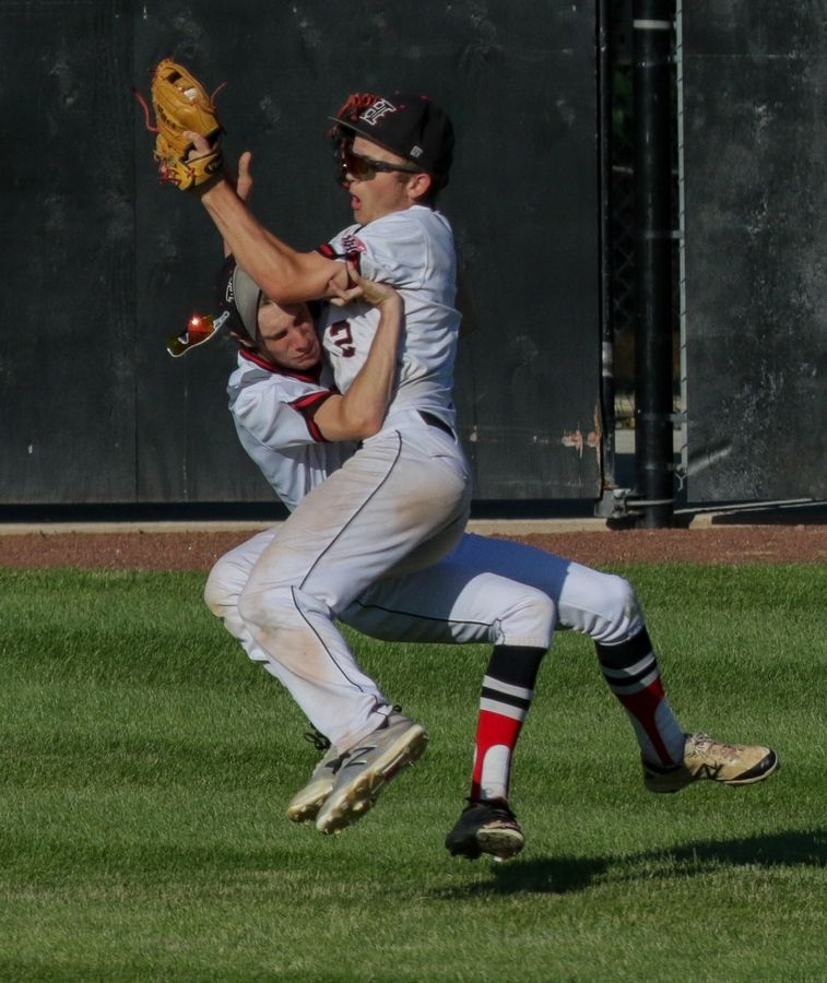 Bev Horne/bhorne@dailyherald.comHuntley's Joey Petryniec, left and AJ Henkle collide in the outfield during action against Loyola in Class 4A sectional semifinal baseball at Boomers Stadium in Schaumburg on Monday. Henkle caught the ball for an out in the 3rd inning.