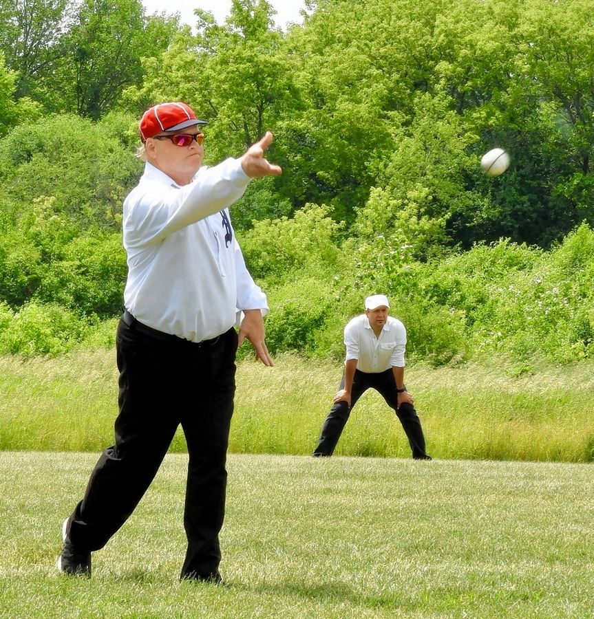 "Hurler Jeff Purtell of Union ""uncorks a pitch"" during the June Civil War-era ""base ball"" game last June."