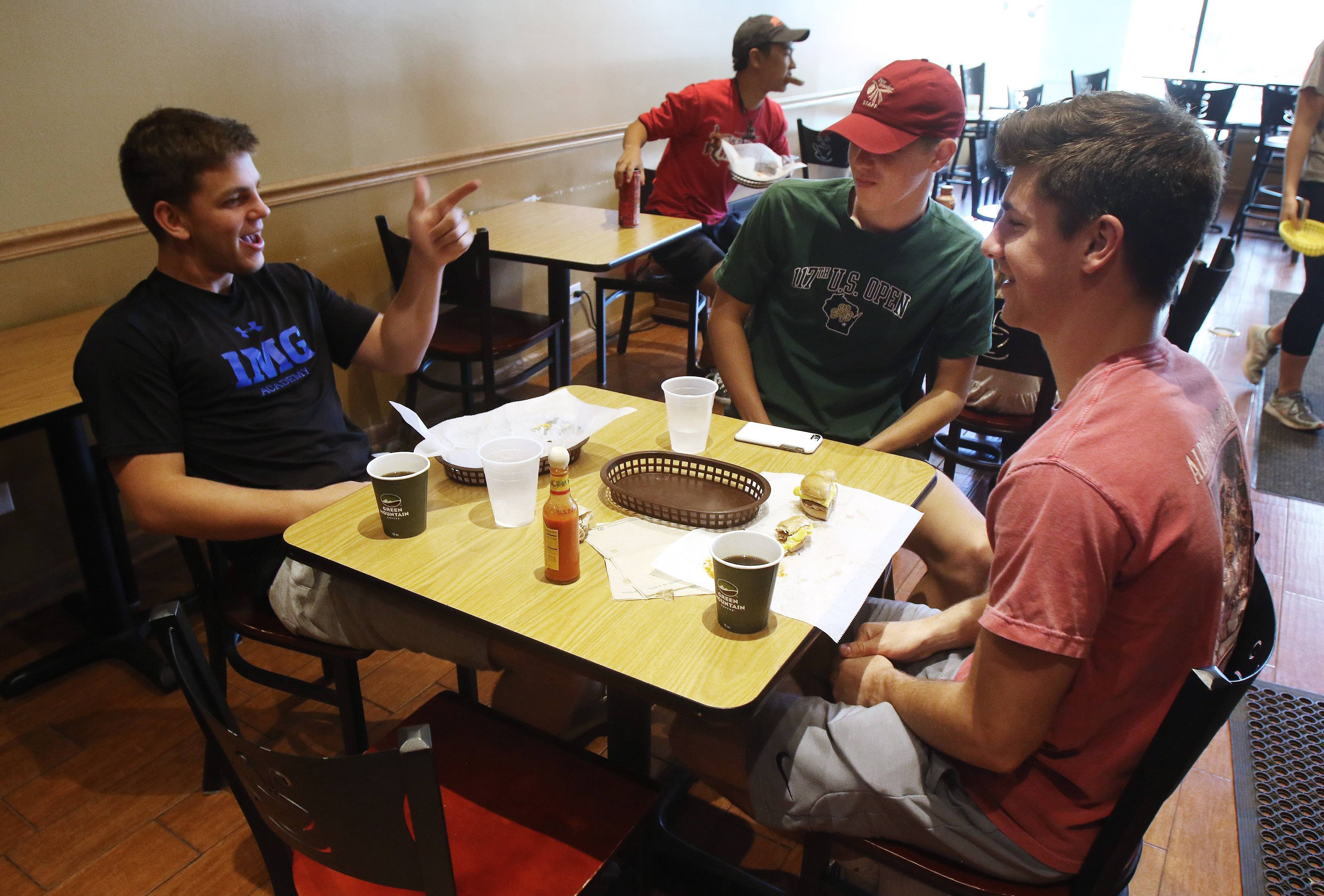 Libertyville residents Jackson Petersen, left, Ryan Cote and Anthony Brucato, all 19, at Bagels by the Book in Libertyville.