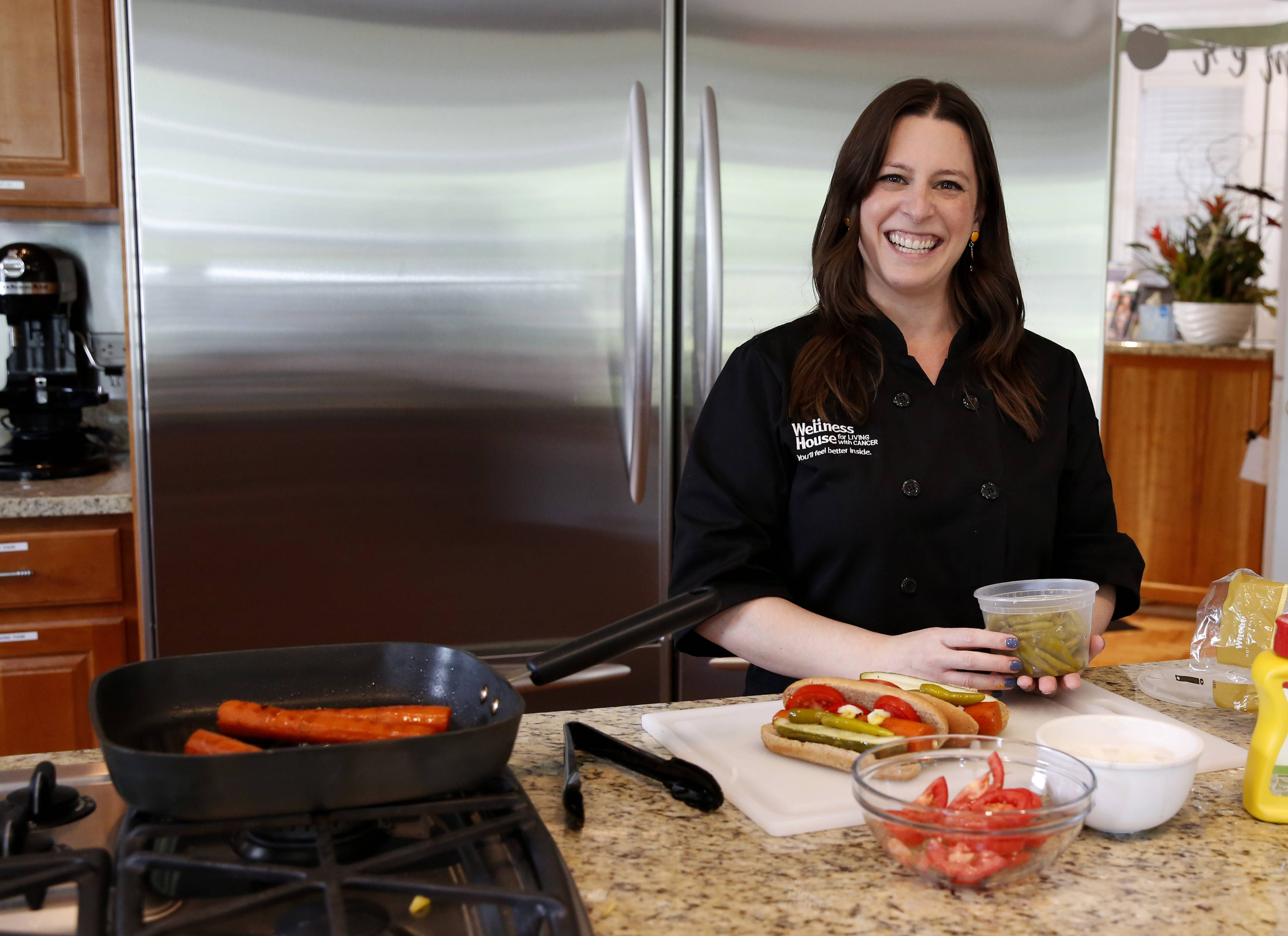Angela Dennison, RD, LDN, oncology dietitian, for the Wellness House in Hinsdale sears carrots in Avocado oil to create a special Chicago style carrot dog.