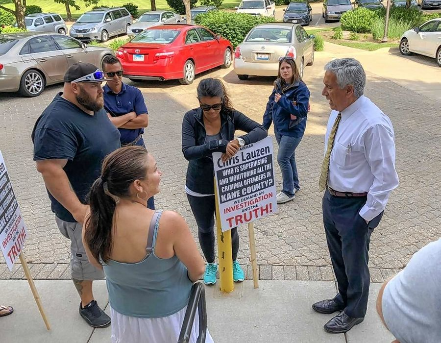 Kane County Board Chairman Chris Lauzen was the subject of most of the picket signs carried by striking probation officers. Lauzen told them there will be no money coming up front from the county to end the stalemate.