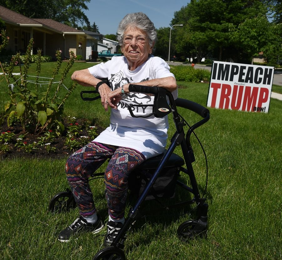 Myra Becker, 94, of Elgin decided to comply Wednesday with the city's request to cut down her oversize political sign, saying it's the message that matters.