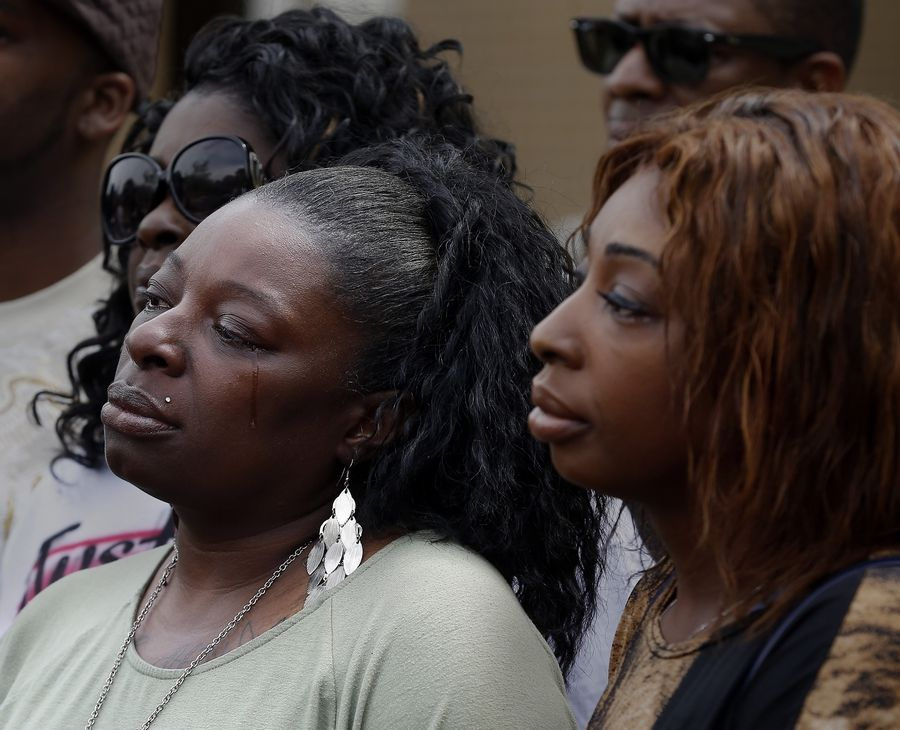 Emmetia Sneed of Aurora, the sister of Decynthia Clements, listens to the news conference Wednesday after relatives filed a federal civil rights lawsuit against the Elgin police officer who shot and killed Clements on March 12.