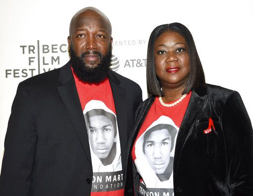 "FILE - In this April 20, 2018 file photo, Trayvon Martin's parents Tracy Martin, left, and Sybrina Fulton attend the Tribeca TV screening of ""Rest in Power: The Trayvon Martin Story"" during the 2018 Tribeca Film Festival in New York. VH1's fifth annual Trailblazer Honors will celebrate acclaimed director Ryan Murphy and Trayvon Martin's parents. The event will air on June 28 on VH1 and Logo. (Photo by Evan Agostini/Invision/AP, File)"