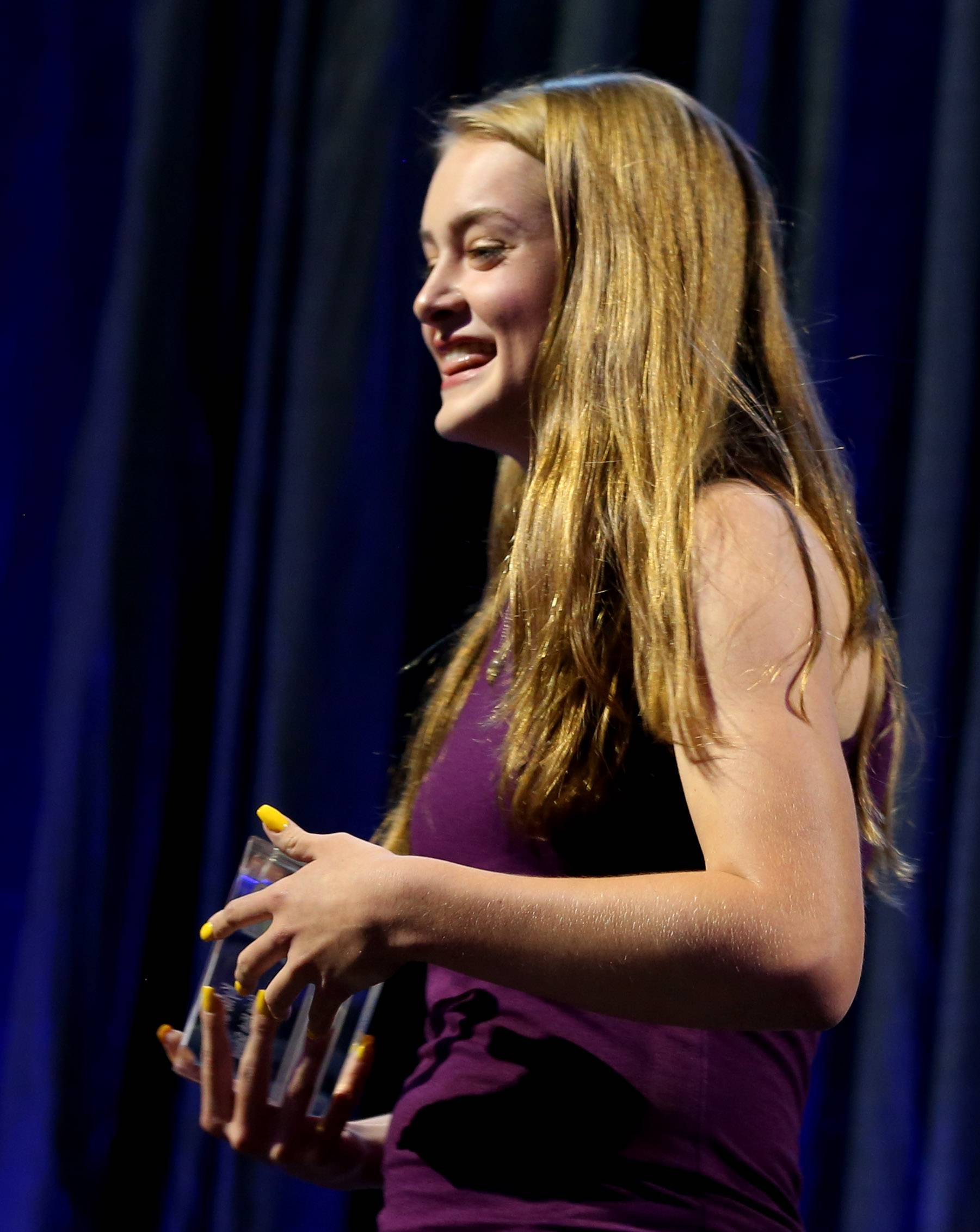 Kylie Graves of Elgin High School holds her Heart and Soul Award on stage Thursdya night as part of the Daily Herald Prep Sports Excellence Awards at the Sears Centre in Hoffman Estates.