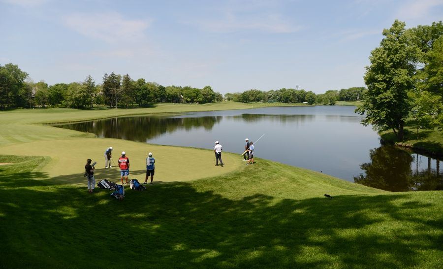 Joe Lewnard/jlewnard@dailyherald.com View of the 9th green during the first round of the Rust-Oleum Championship at the Ivanhoe Club near Mundelein Thursday.