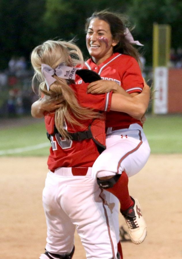 Palatine pitcher Sarah Grossman gets a lift after the final out in a win over Barrington in Class 4A supersectional softball action at Barrington on Monday. The Pirates face Plainfield North in Friday's state semifinals in East Peoria.