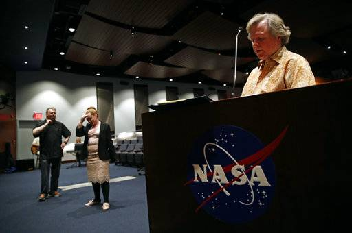 "In this April 12, 2018 photo, director Randy Booth, right, reviews notes as performers Shawn Perry, left, and Sara Collins pause during a Music and Drama Club rehearsal for the musical ""Weird Romance"" at NASA's Goddard Space Flight Center in Greenbelt, Md. The theater club's members include NASA scientists, engineers and managers whose work focuses on everything from weather satellites to space telescopes like Hubble to sophisticated unmanned spacecraft."