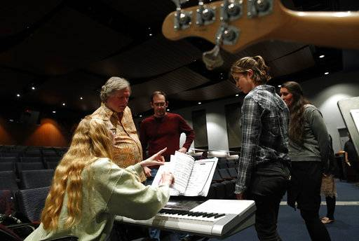 "In this April 12, 2018 photo, director Randy Booth, top left, and keyboardist Susan Breon, bottom left, review musical cues with performers during a Music and Drama Club rehearsal for the musical ""Weird Romance"" at NASA's Goddard Space Flight Center review musical cues during a rehearsal in Greenbelt, Md. ""We've got more engineers per square foot than any other theater group around,"" said Barth."