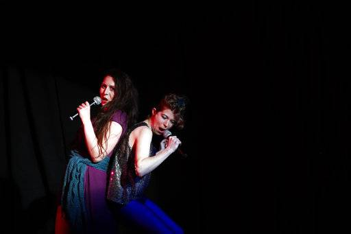 "In this May 1, 2018 photo, Melanie Pino-Elliott, left, and Katrina Jackson perform during a Music and Drama Club dress rehearsal for the musical ""Weird Romance"" at NASA's Goddard Space Flight Center in Greenbelt, Md."