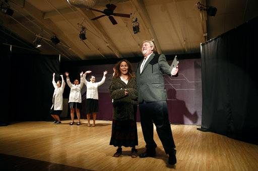 "In this May 1, 2018 photo, Mary Estacion, front left, and Don Mitchell perform during a Music and Drama Club dress rehearsal for the musical ""Weird Romance"" at NASA's Goddard Space Flight Center in Greenbelt, Md."