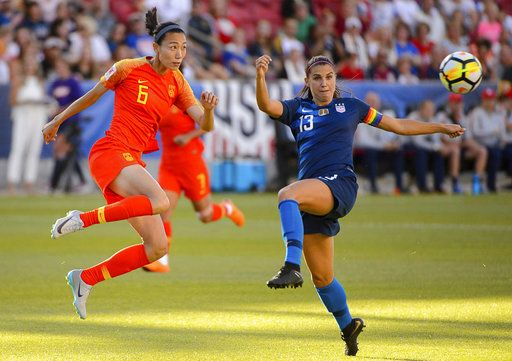 China defender Lin Yuping and U.S. forward Alex Morgan watch the ball during an international friendly soccer match in Sandy, Utah, Thursday, June 7, 2018. (Trent Nelson/The Salt Lake Tribune via AP)
