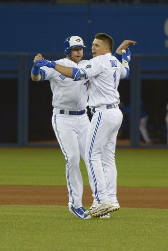 Toronto Blue Jays' Aledmys Hernandez, right, celebrates with Justin Smoak after hitting a walk-off single against the Baltimore Orioles during the 10th inning of a baseball game Thursday, June 7, 2018, in Toronto. (Jon Blacker/The Canadian Press via AP)