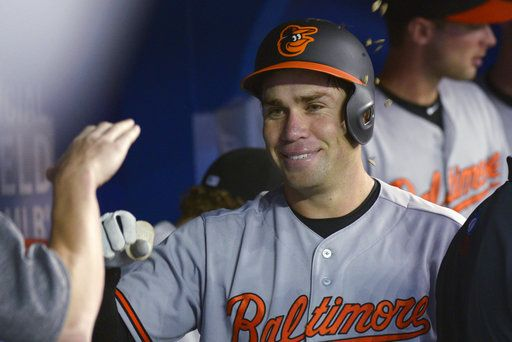 Baltimore Orioles' Austin Wynns celebrates in the dugout after hitting his first home run in the majors, against the Toronto Blue Jays during the seventh inning of a baseball game Thursday, June 7, 2018, in Toronto. (Jon Blacker/The Canadian Press via AP)