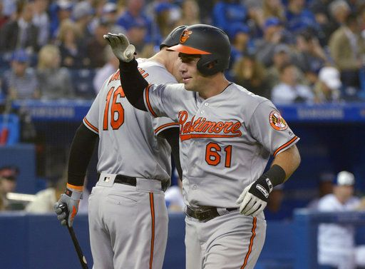 Baltimore Orioles' Austin Wynns, right, celebrates with Trey Mancini after hitting a home run against the Toronto Blue Jays during the seventh inning of a baseball game Thursday, June 7, 2018, in Toronto. (Jon Blacker/The Canadian Press via AP)