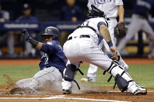 Seattle Mariners' Jean Segura (2) scores ahead of the tag by Tampa Bay Rays catcher Wilson Ramos on a single by Mitch Haniger during the second inning of a baseball game Thursday, June 7, 2018, in St. Petersburg, Fla.