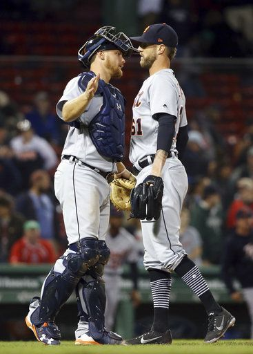 Detroit Tigers closer Shane Greene and catcher John Hicks chest-bump to celebrate the Tigers' 7-2 victory over the Boston Red Sox in a baseball game at Fenway Park, Thursday, June 7, 2018, in Boston.