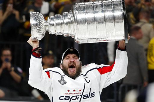 Washington Capitals left wing Alex Ovechkin, of Russia, hoists the Stanley Cup after the Capitals defeated the Golden Knights in Game 5 of the NHL hockey Stanley Cup Finals Thursday, June 7, 2018, in Las Vegas.