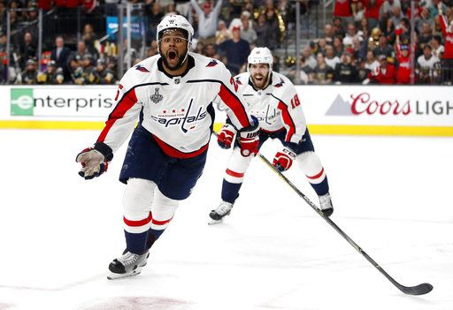 Washington Capitals right wing Devante Smith-Pelly, left, celebrates his goal, in front of center Chandler Stephenson during the third period in Game 5 of the NHL hockey Stanley Cup Finals against the Vegas Golden Knights on Thursday, June 7, 2018, in Las Vegas.