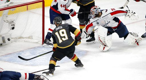 Vegas Golden Knights right wing Reilly Smith, left, scores on Washington Capitals goaltender Braden Holtby during the second period in Game 5 of the NHL hockey Stanley Cup Finals on Thursday, June 7, 2018, in Las Vegas.