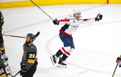Washington Capitals center Lars Eller, right, celebrates his goal as Vegas Golden Knights left wing William Carrier skates away during the third period in Game 5 of the NHL hockey Stanley Cup Finals on Thursday, June 7, 2018, in Las Vegas.