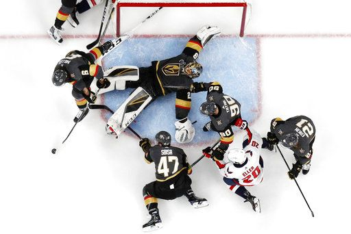 Vegas Golden Knights goaltender Marc-Andre Fleury, top center, flops as he tries to stop a shot during the second period in Game 5 of the NHL hockey Stanley Cup Finals against the Washington Capitals on Thursday, June 7, 2018, in Las Vegas.