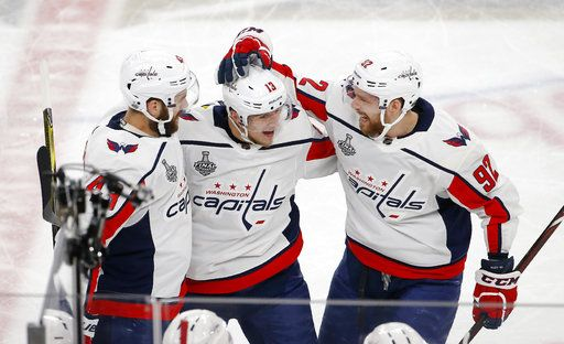 Washington Capitals left wing Jakub Vrana, center, celebrates his goal with right wing Tom Wilson, left, and center Evgeny Kuznetsov during the second period in Game 5 of the NHL hockey Stanley Cup Finals against the Vegas Golden Knights on Thursday, June 7, 2018, in Las Vegas.