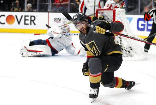 Vegas Golden Knights left wing Tomas Tatar, right, of Slovakia, celebrates a goal by left wing David Perron as Washington Capitals goaltender Braden Holtby, left, lies on the ice during the second period in Game 5 of the NHL hockey Stanley Cup Finals on Thursday, June 7, 2018, in Las Vegas.