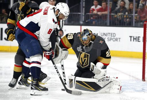 Washington Capitals left wing Alex Ovechkin, of Russia, tries to get a shot past Vegas Golden Knights goaltender Marc-Andre Fleury during the first period in Game 5 of the NHL hockey Stanley Cup Finals on Thursday, June 7, 2018, in Las Vegas.
