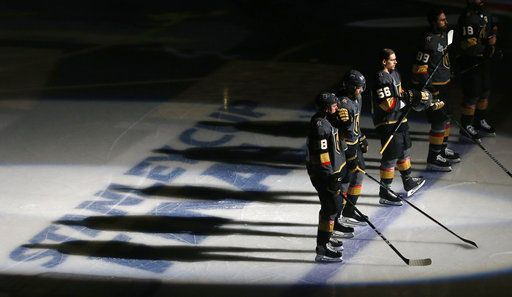 Members of the Vegas Golden Knights line up for the national anthem prior to Game 5 of the NHL hockey Stanley Cup Finals against the Washington Capitals on Thursday, June 7, 2018, in Las Vegas.