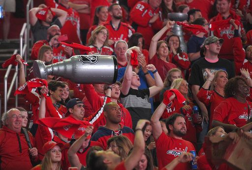 Fans react during a viewing party for Game 5 of the NHL hockey Stanley Cup Final between the Washington Capitals and the Vegas Golden Knights, Thursday, June 7, 2018, in Washington.