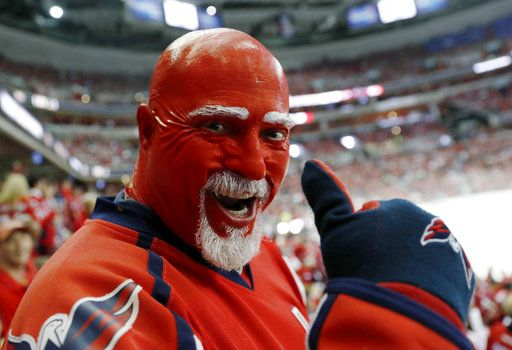 A Washington Capitals fan wears team colors during the first period in Game 4 of the NHL hockey Stanley Cup Final between the Capitals and the Vegas Golden Knights, Monday, June 4, 2018, in Washington.