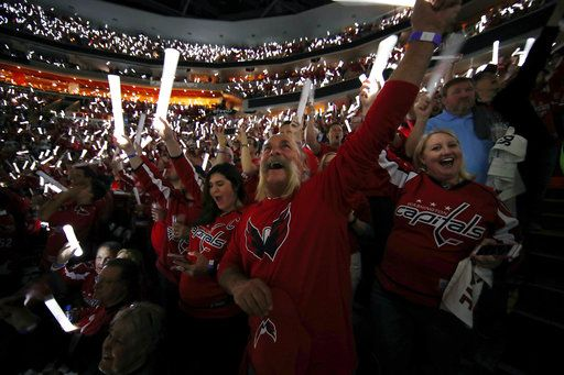 Washington Capitals fans wave wbwefore Game 4 of the NHL hockey Stanley Cup Final between the Capitals and the Vegas Golden Knights, Monday, June 4, 2018, in Washington.