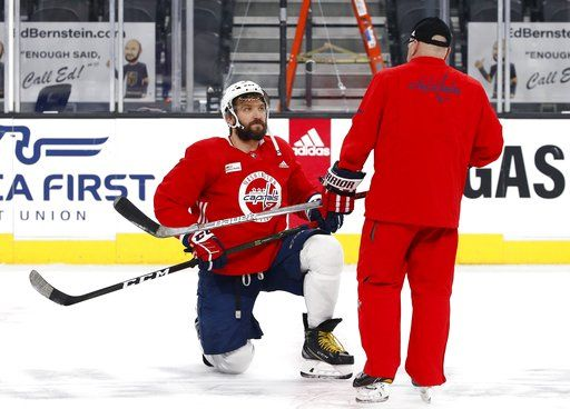 Washington Capitals head coach Barry Trotz, right, talks with Alex Ovechkin, left, during an NHL hockey practice Wednesday, June 6, 2018, in Las Vegas. The Capitals lead the Vegas Golden Knights 3-1 in the best-of-seven Stanley Cup Finals series.