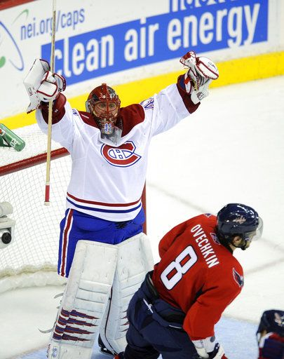 FILE - In this April 28, 2010, file photo, Montreal Canadiens goalie Jaroslav Halak, of Slovakia, celebrates the team's 2-1 win as Washington Capitals left wing Alex Ovechkin (8), of Russia, skates off after Game 7 of the NHL hockey playoff series in Washington.  It's as though all the bad breaks from the previous 42 seasons of Washington Capitals hockey are being erased - or at least somewhat forgotten - in a run that could deliver the franchise's first title. The Capitals lead Vegas three games to one in the best-of-seven Stanley Cup Finals. Game 5 is Thursday, June 7, 2018.