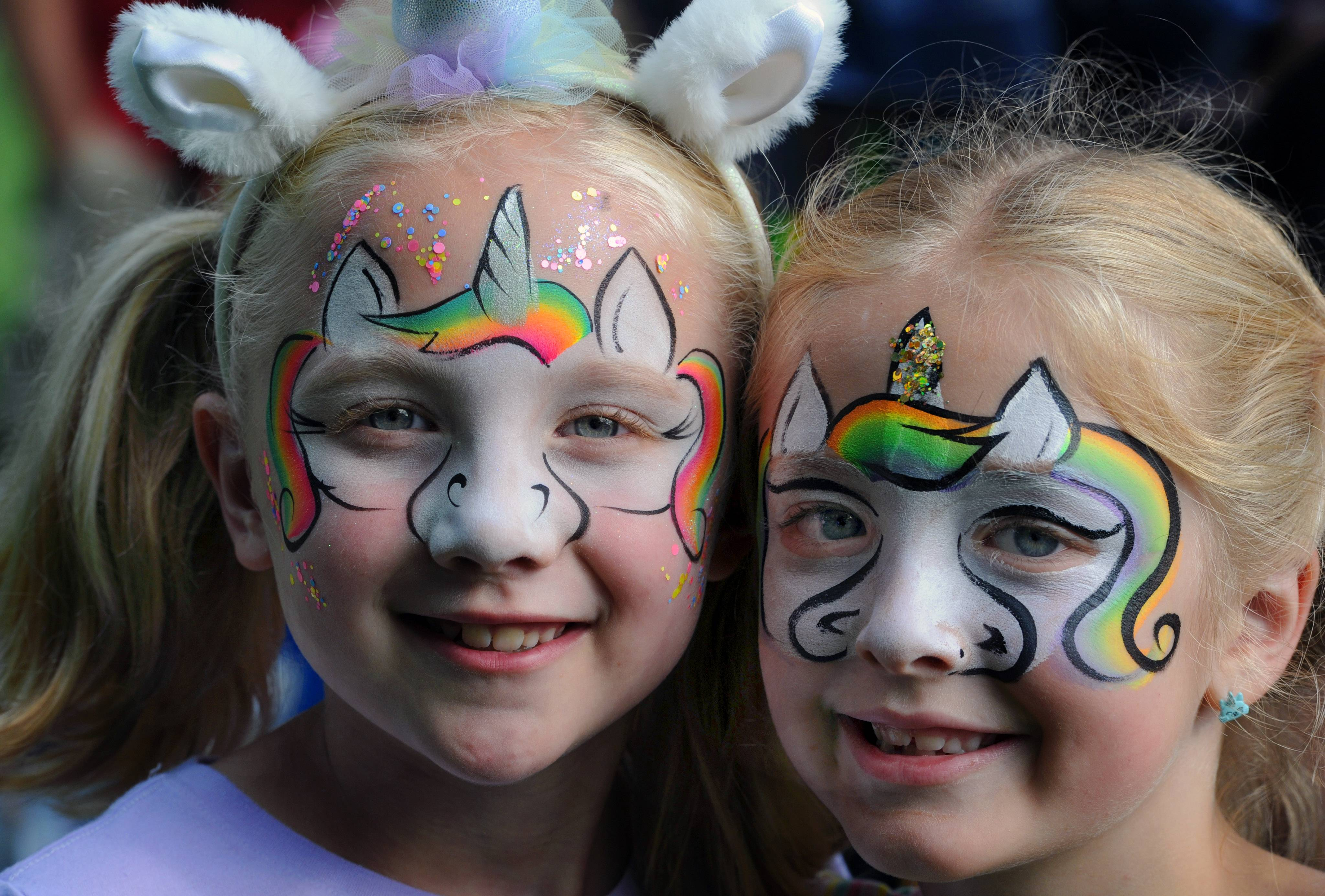 Maddie Affatati, 7, and her friend Sophia Marino, 7, both of Arlington Heights, got their faces painted to look magical during Picnic in the Park Friday at North School Park in Arlington Heights.