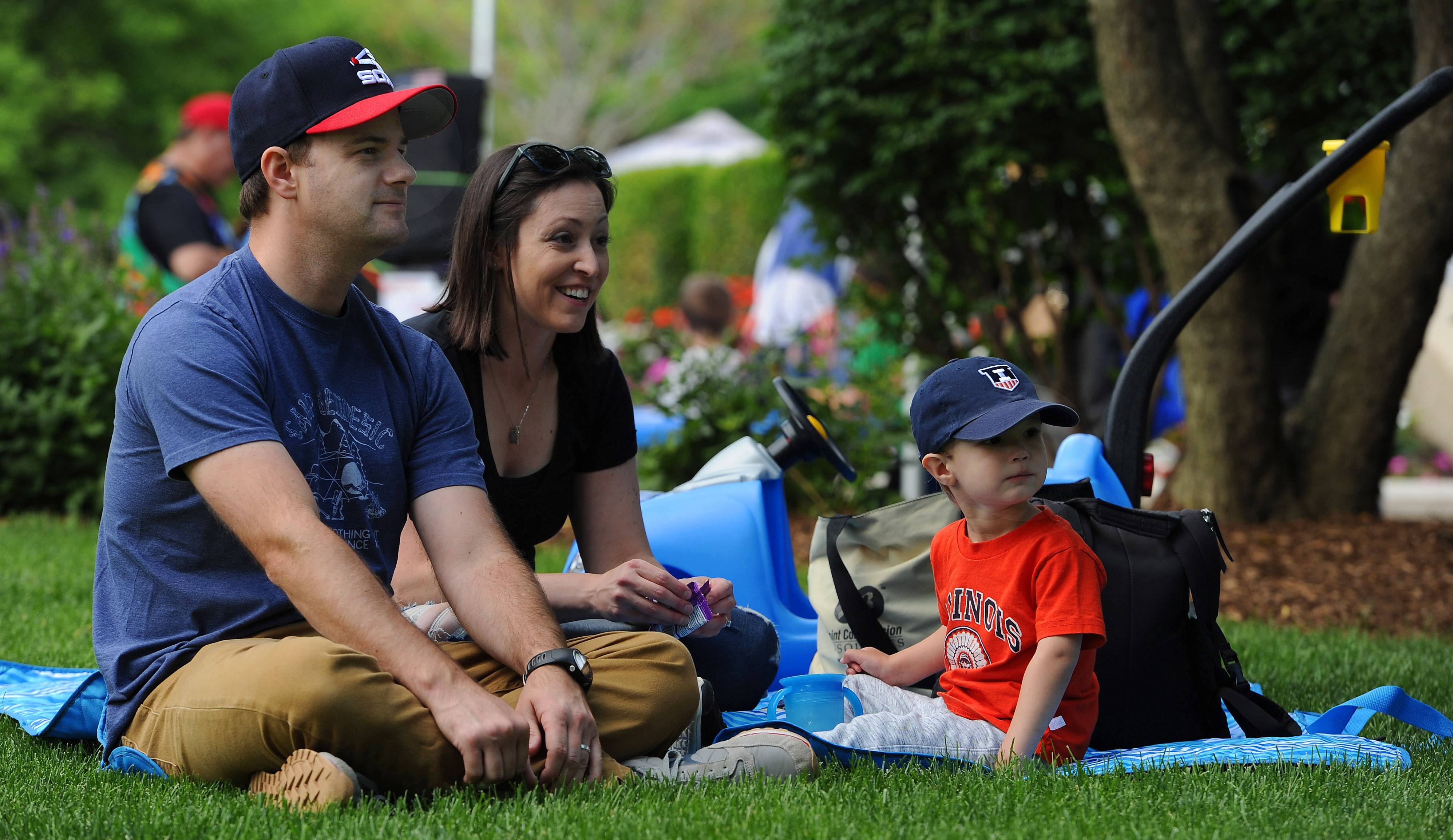 Michael Schlaak and his wife Jackie entertain their son Truman, 2, during Picnic in the Park Friday at North School Park in Arlington Heights.