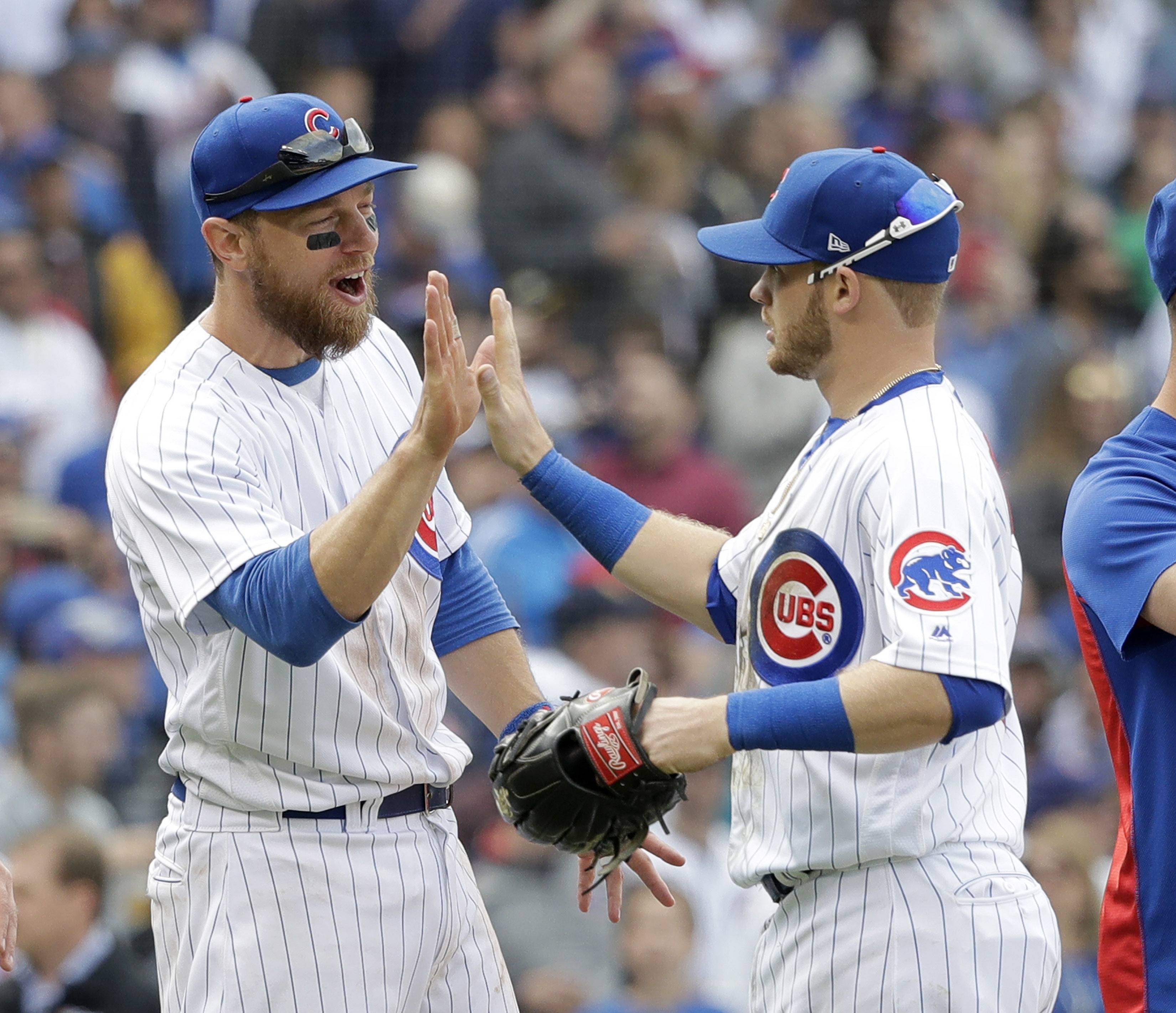 Chicago Cubs' Ben Zobrist, left, and Ian Happ celebrate their 3-1 win over the Pittsburgh Pirates at Wrigley Field. Zobrist had a couple key hits and Happ made 3 outstanding plays in left to seal the win for the Cubs.