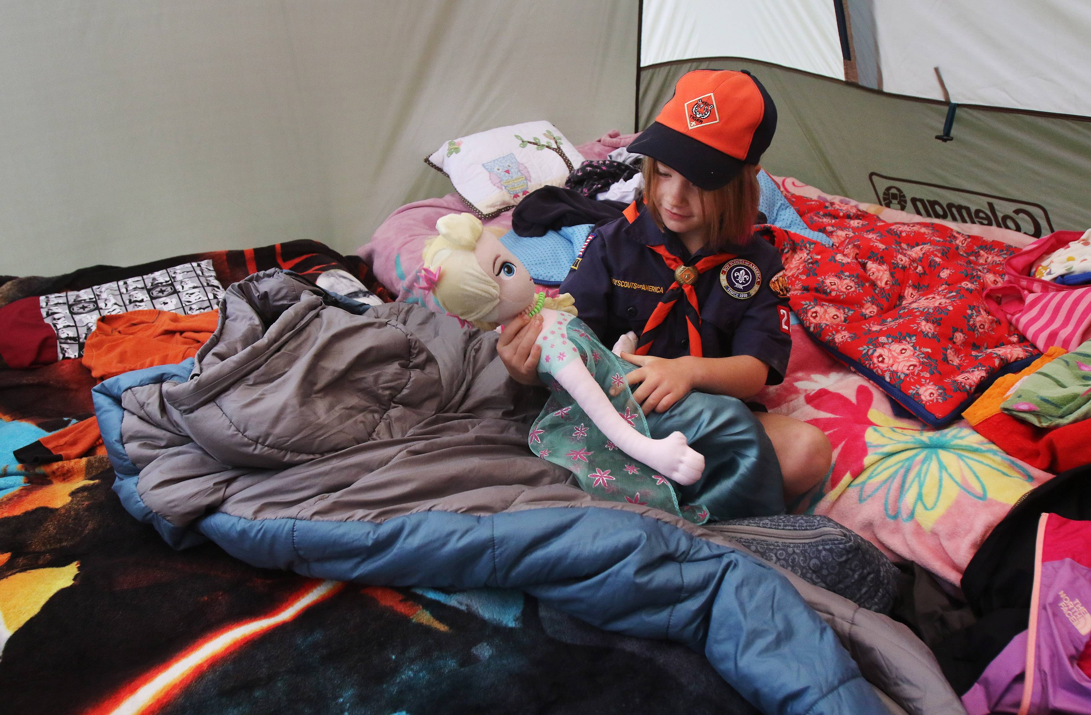 Addison Carver plays with her Elsa doll in her tent during a campout with Cub Scouts Pack 229 at Kettle Moraine State Forest in Wisconsin. Addison joined Cub Scouts this February as one of the first 13 girls in the suburbs to take part in the program.