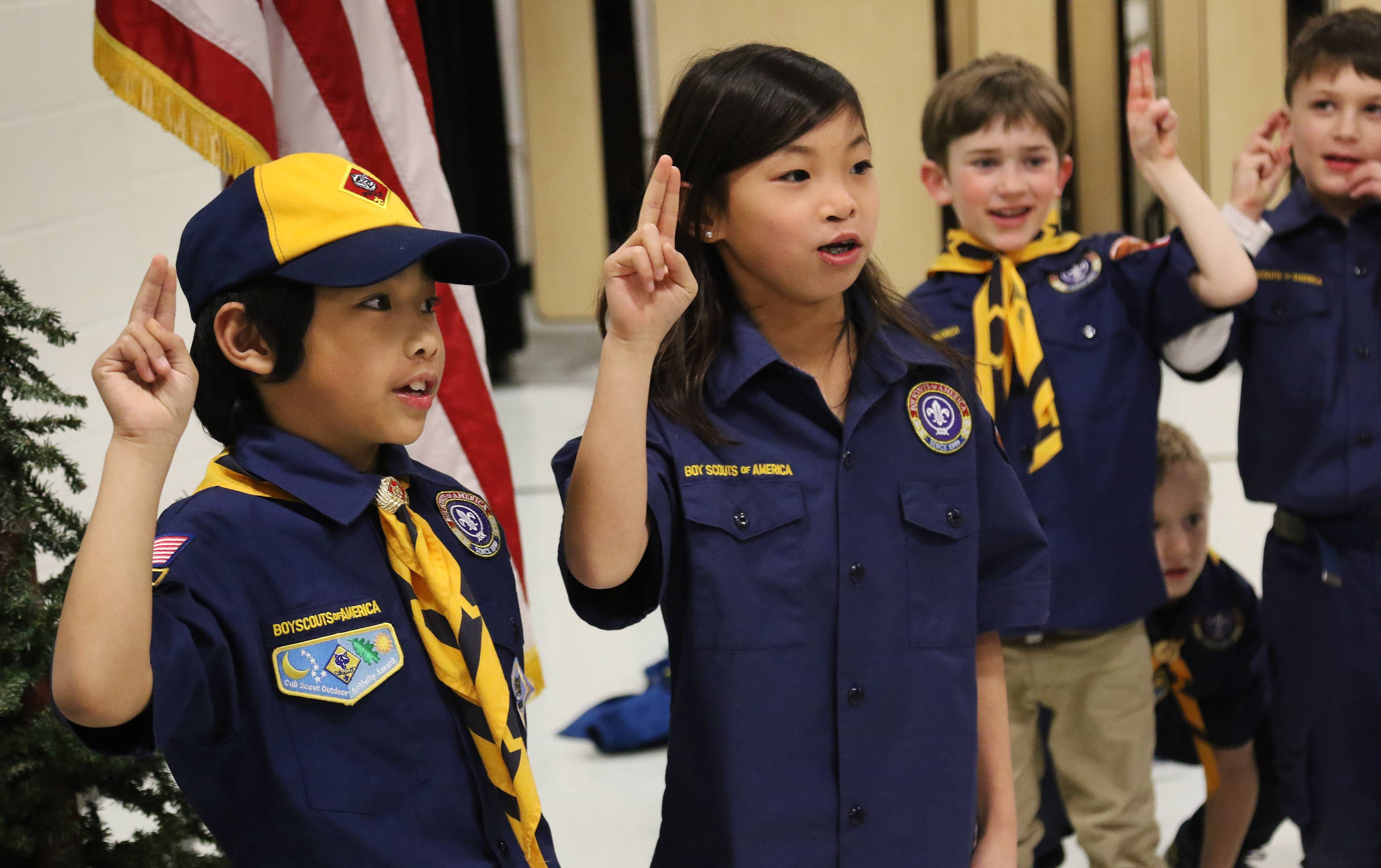 Cub Scout Matthew Kalt of Barrington Hills, left, and Lucy Vraniak of Tower Lakes recite the Scout Law during a meeting of Cub Scouts Pack 229 at North Barrington Elementary School.