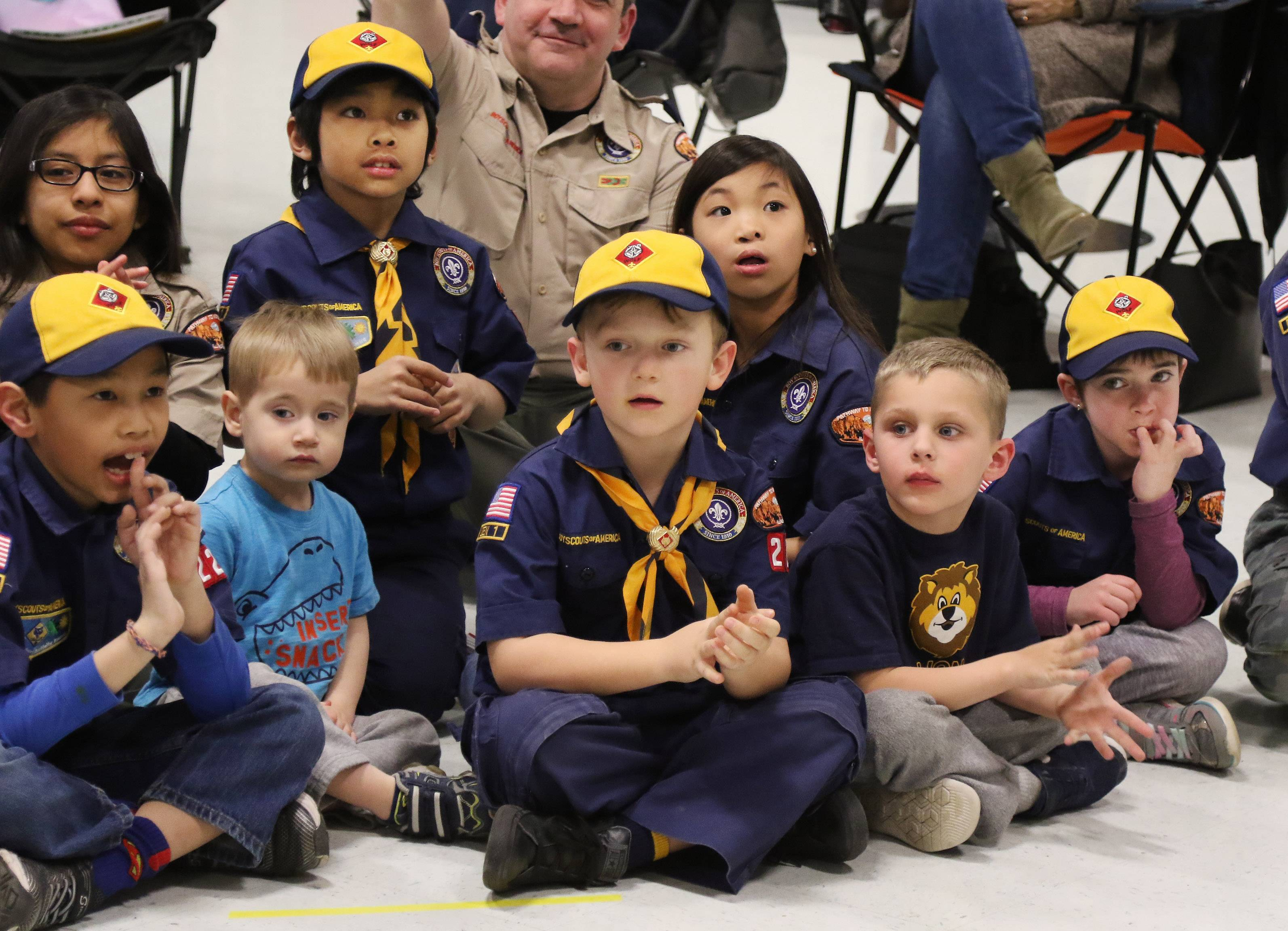 Boys and girls watch a skit during a meeting of Cub Scouts Pack 229, one of the first in the region to allow girls before all Cub Scouting units will be open to female participants June 11.