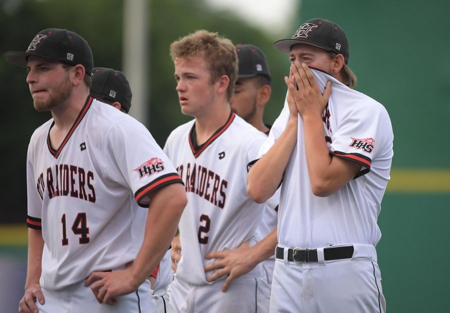 Huntley's Kyle Morgan covers his face after the Red Raiders lost 4-3 to Plainfield North in the Class 4A baseball state championship game at Route 66 Stadium in Joliet on Saturday.