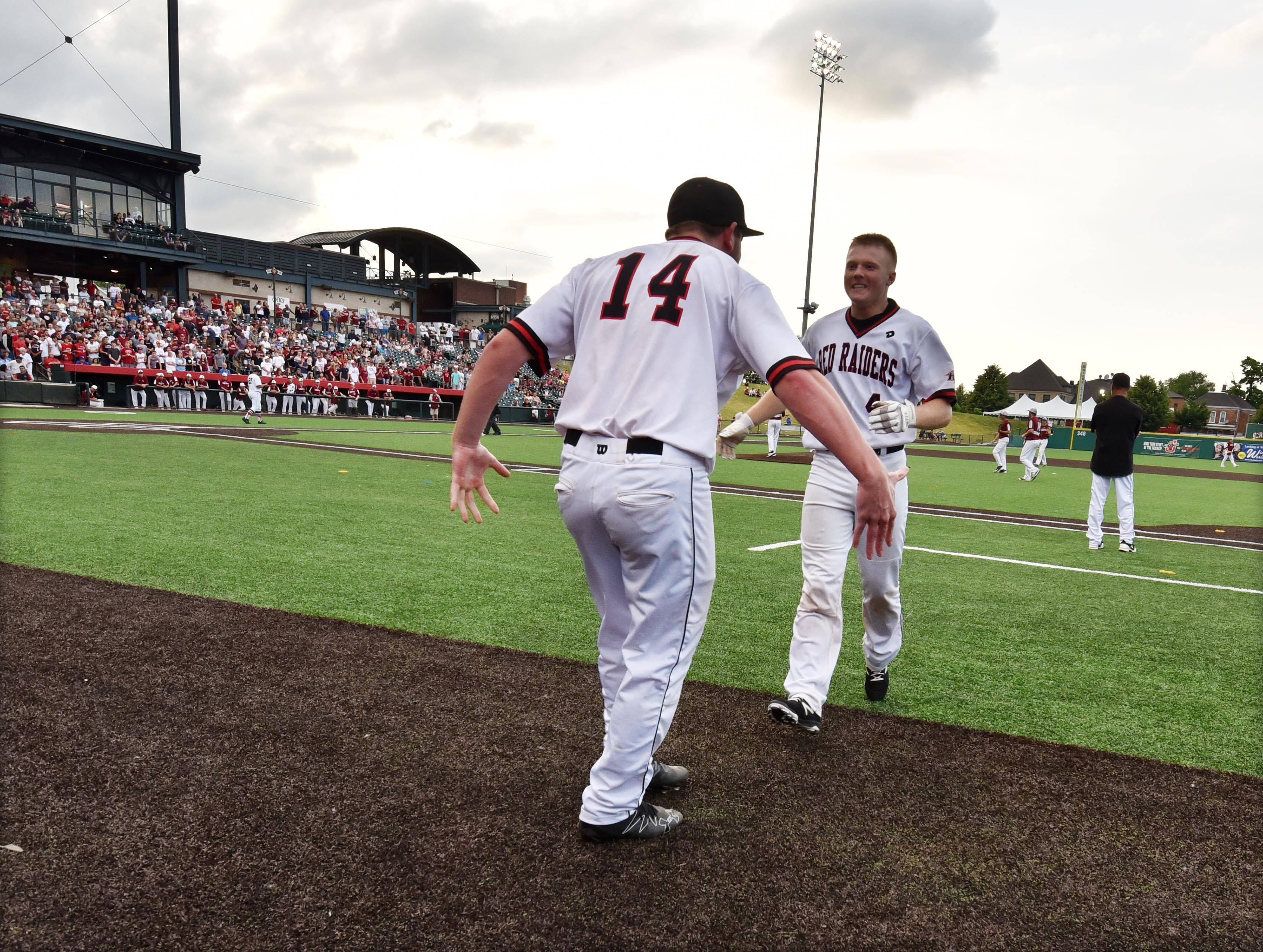 Huntley's Joe Rosenthal goes to greet Kamrin Hoffmann after his hit in the seventh inning against Plainfield North in the Class 4A baseball state championship game at Route 66 Stadium in Joliet on Saturday.